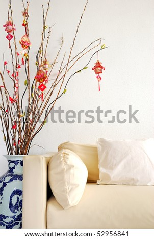 Chinese Lunar New Year decoration with modern sofa. For New Year objects, celebration and festival, and culture and lifestyle concepts. - stock photo