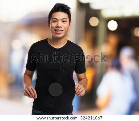 chinese man holding a vinyl - stock photo