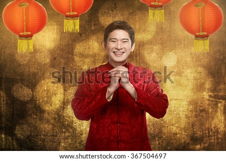 Chinese man smiling. Happy chinese new year concept - stock photo