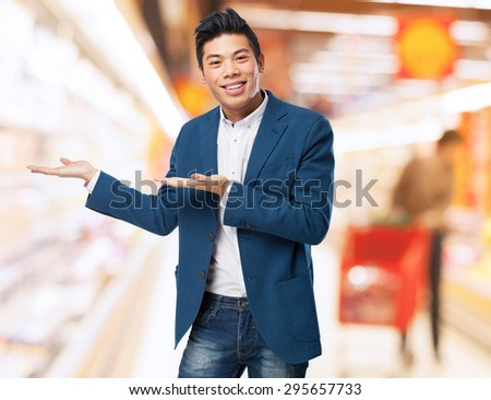 chinese man welcome gesture - stock photo