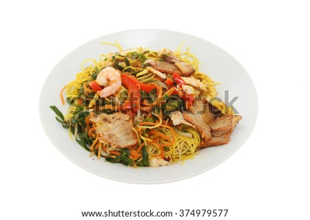 Chinese meal, Singapore noodles in a bowl isolated against white - stock photo