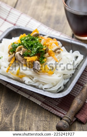 Chinese mix vegetables and rice noodles on table - stock photo