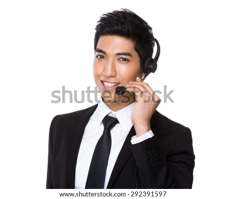 Chinese mixed Indian businessman with headset for hotline job aspect - stock photo