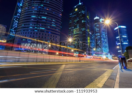chinese modern city at night,light trails on the street in shanghai - stock photo