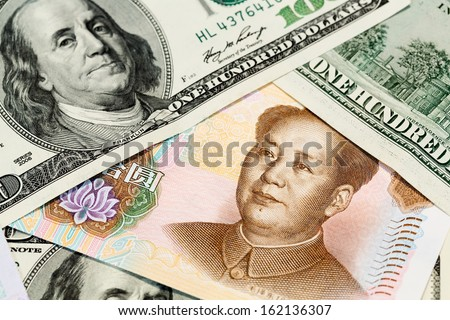 Chinese money and american dollar close up view as background - stock photo