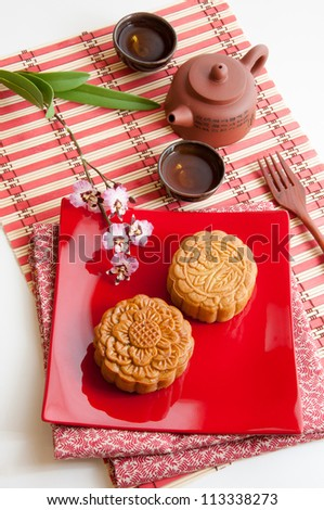 Chinese moon cake, food for Chinese mid-autumn festival and traditional tea. - stock photo