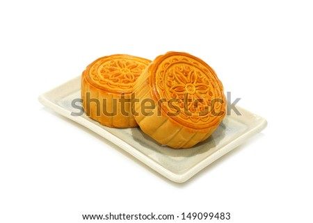Chinese Moon cake on white background. (Patterns of flowers on the moon cake is not a logo or trademark.) - stock photo