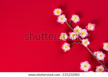 chinese new year cherry blossom flowers with copyspace for design purpose - stock photo
