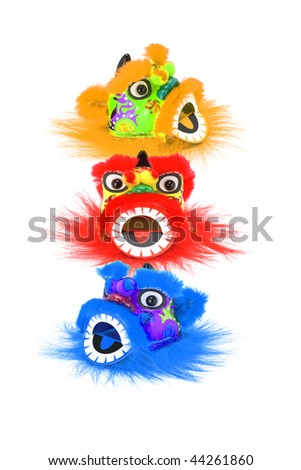 Chinese new year colorful lion head ornaments on white - stock photo