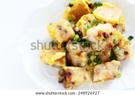 Chinese new year food, fried turnip cake with egg - stock photo