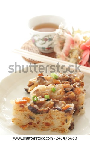 chinese new year food, turnip cake sliced and fried on dish for dim sum image - stock photo