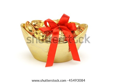 Chinese New Year gold decorative ingots with red bow ribbon on white background - stock photo