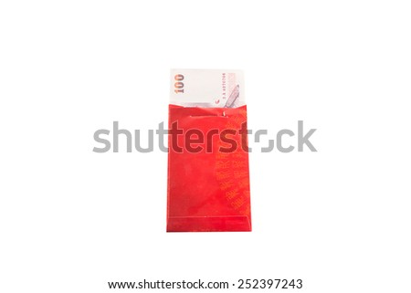 Chinese new year money in red packet gift on white background. - stock photo