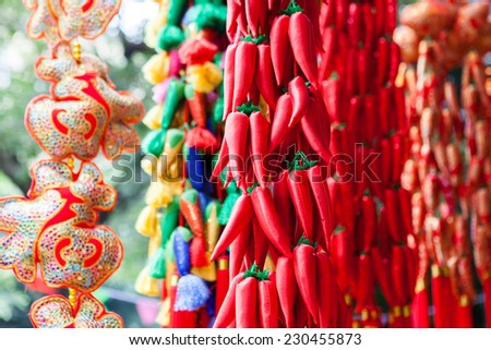 Chinese new year ornament in a traditional open market. - stock photo