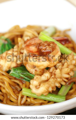 Chinese noodle stir with  squid and shrimp - stock photo