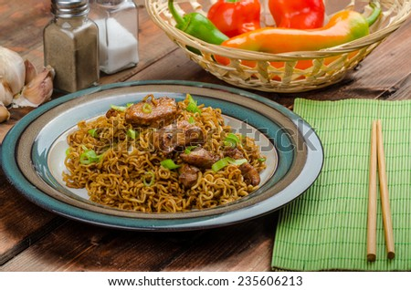 Chinese noodles with chicken and onion, peppers and soy - stock photo