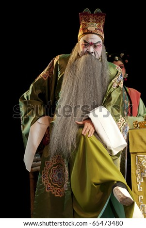 Chinese opera actor with traditional face painting - stock photo