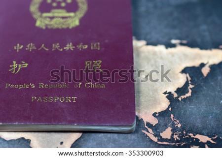 Chinese passport and map - stock photo