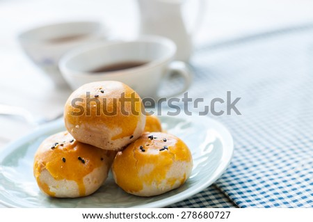 Chinese pastry moon cake with cup of tea - stock photo