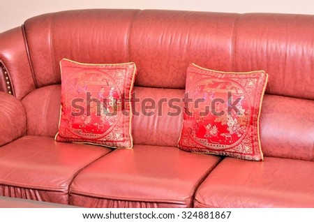 Chinese pattern in red pillows on red sofa set - stock photo