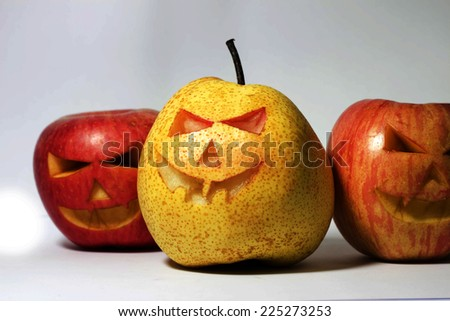 Chinese pear and apple for halloween - stock photo