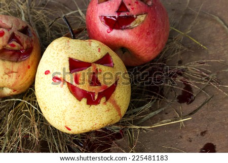 Chinese pear and apple for halloween on hay - stock photo