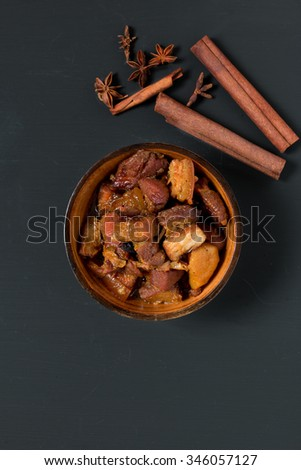 Chinese pork belly caramelized and braised in soy sauce with star anise, cinnamon and chilies.  - stock photo