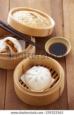 chinese pork bun in bamboo basket - stock photo