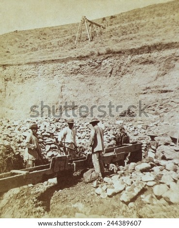 Chinese prospectors washing gold in a sluice box placed in the stream to channel water flown. 1871 photo by William Henry Jackson, probably taken during the Wheeler expedition. - stock photo