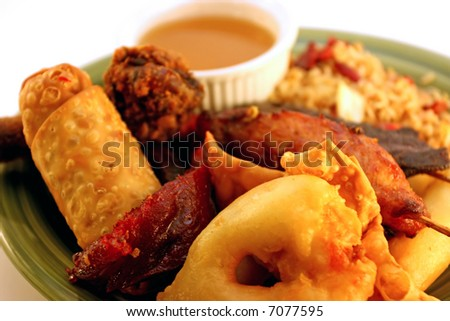 Chinese pu pu platter on plate with rice and sauce - stock photo