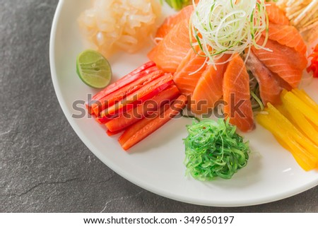 Chinese raw fish salad, a native of China. - stock photo