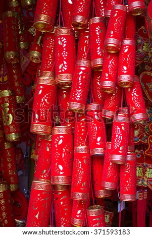 chinese red fake firecrackers,words mean best wishes and good luck for the coming chinese new year - stock photo