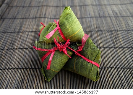 Chinese Rice Dumplings on bamboo mat  - stock photo