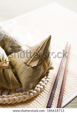 Chinese rice dumplings on bamboo place mat - stock photo