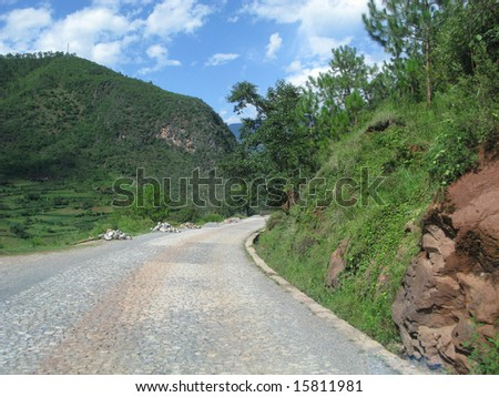 Chinese road in Yunnan province, going to Lugu Lake - stock photo