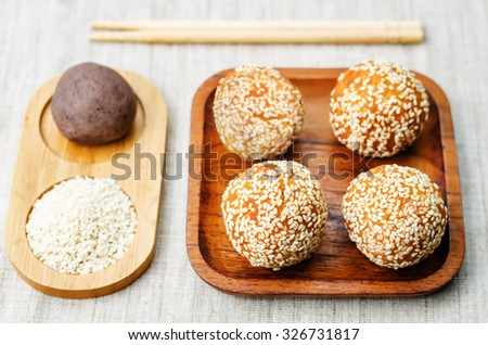 Chinese sesame balls with sweet red bean paste on a light background. toning. selective focus - stock photo