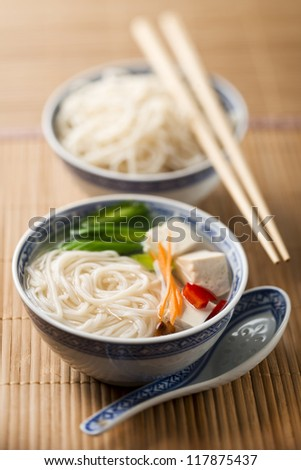 Chinese soup with tofu, vegetables and noodles - stock photo