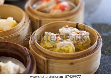 Chinese Streamed Dumpling in Bamboo Basket - stock photo