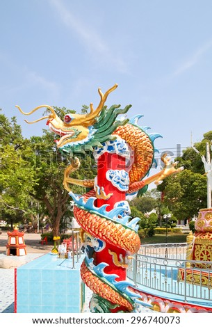Chinese style dragon statue soft focus,Chinese Dragon Wrapped around red pole - stock photo