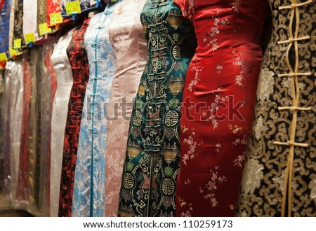 Chinese style dresses. Temple street market. Hong Kong. - stock photo