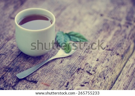 Chinese style herbal floral tea over wood table with raw ingredients   - stock photo