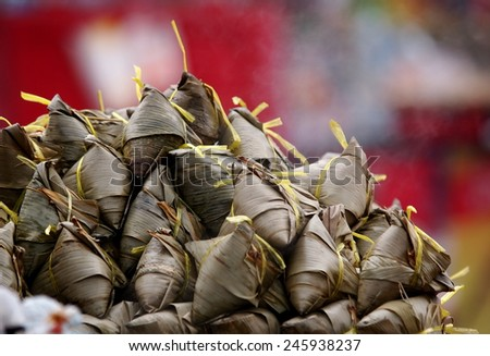 chinese style meal food menu made of rice and meat with asian ingredient wrapped with banana leaves cooking with steam for sale on street markets and cultural festival in asian and THAILAND - stock photo