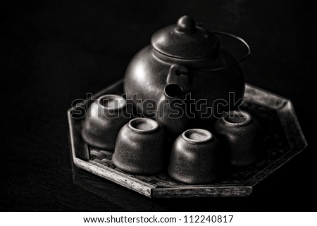 Chinese style tea set in black and white - stock photo