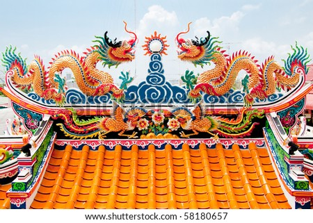 Chinese style twin dragon sculpture in the roof top, Chonburi Thailand - stock photo