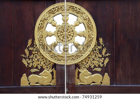chinese style wooden door with golden ornamental at dragon temple in Thailand - stock photo