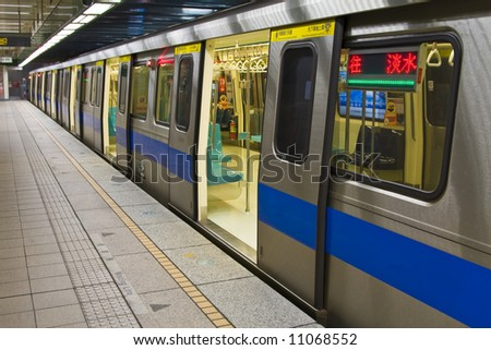 Chinese subway train at the platform with doors open - stock photo