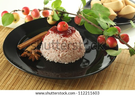 Chinese sweet rice dessert with small apples - stock photo