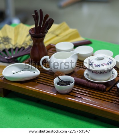Chinese tea ceremony with tea leaves - stock photo