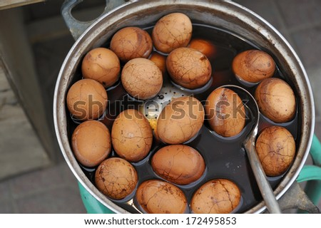 Chinese Tea Eggs, the peel is cracked intentionally to allow spices and flavor to seep in - stock photo