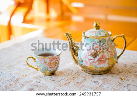 Chinese tea set on wooden table - stock photo